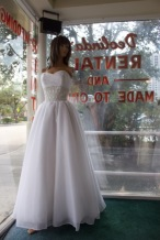 Impressions Style #2288 Size: 8 color: white, has detachable train and fabric is organza