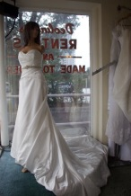 Impressions Style #2975 Size 14 color: dim white, has beaded applique belt with rhinstone buttons and corset