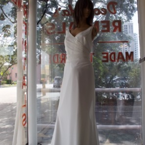 Impressions Style #4820 Size 14-16 color: white, has a v-neck and a v-back