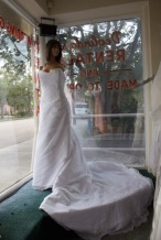 Impressions Style #V471 Size: 18 color: white, has lace appliques with a long train
