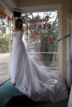 Impressions Style: C2308 Size: 12 color: white, has beaded neck, long train, white cover buttons, and built in corset